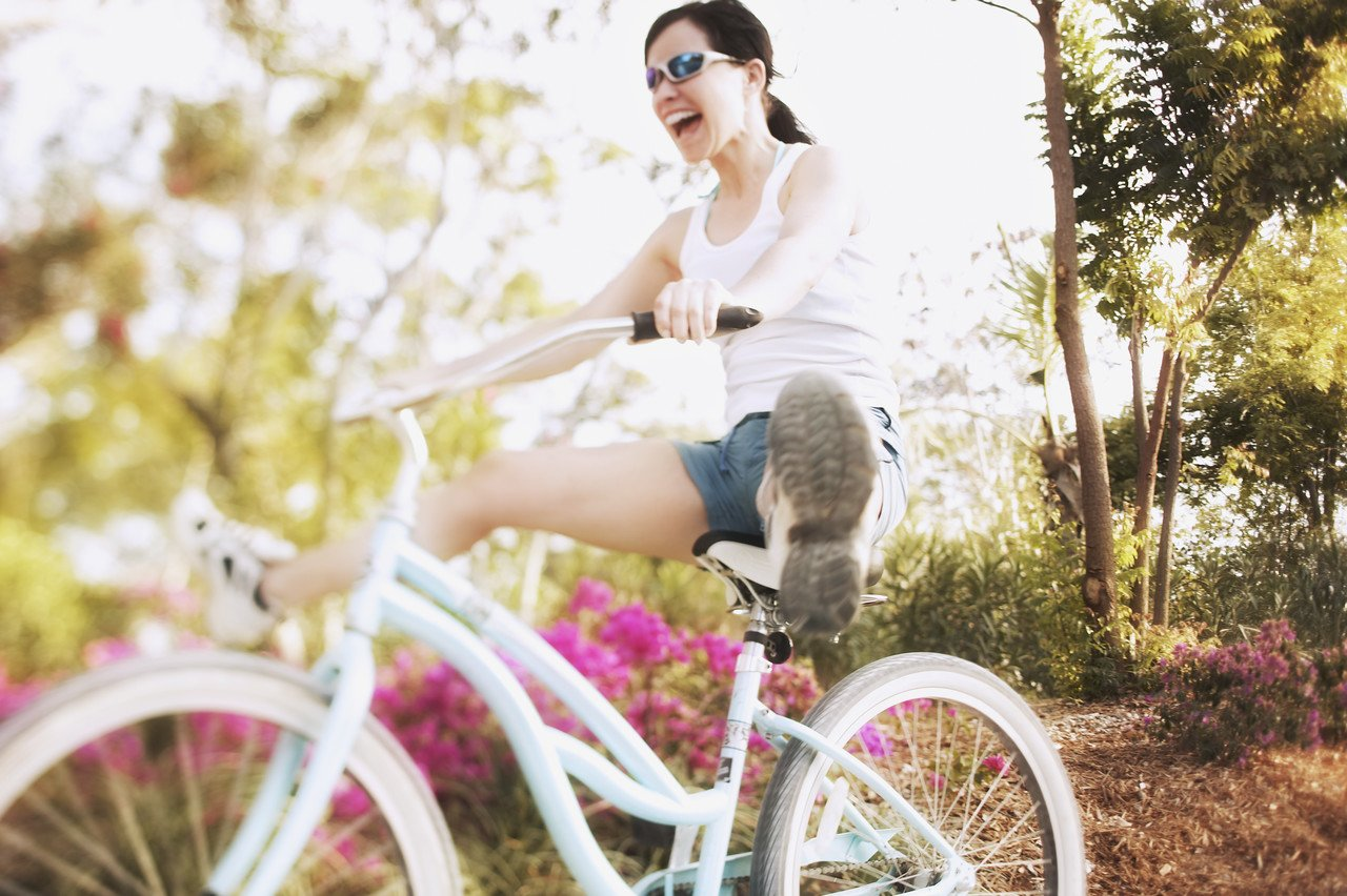 A happy healthy woman is biking free of pain!